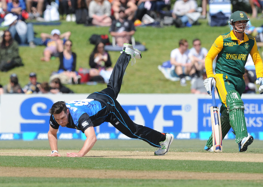 New Zealand's Mitchell McClenaghan takes a tumble bowling against South Africa in the 2nd ODI International cricket match at Blake Park, Mt Maunganui, New Zealand, Friday, October 24, 2014. Credit:SNPA / Ross Setford