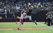 Sep 15, 2019; Oakland, CA, USA; Oakland Raiders wide receiver Tyrell Williams (16) catches a pass in the first quarter over Kansas City Chiefs defensive back Bashaud Breeland (21) at Oakland-Alameda County Coliseum. The Chiefs defeated the Raiders 28-10..(Gerome Wright/Image of Sport)