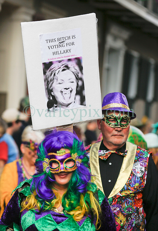 31 January 2016. New Orleans, Louisiana.<br /> Bill and Hillary Clinton inspired placards in the crowd at the Mardi Gras Dog Parade. The Mystic Krewe of Barkus winds its way around the French Quarter with dogs and their owners dressed up for this year's theme, 'From the Doghouse to the Whitehouse.' <br /> Photo&copy;; Charlie Varley/varleypix.com