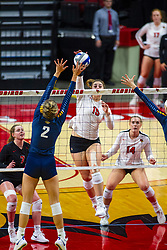BLOOMINGTON, IL - September 15:  Monica Miller strikes the ball towards Hannah Vanden Berg during a college Women's volleyball match between the ISU Redbirds and the Marquette Golden Eagles on September 15 2019 at Illinois State University in Normal, IL. (Photo by Alan Look)