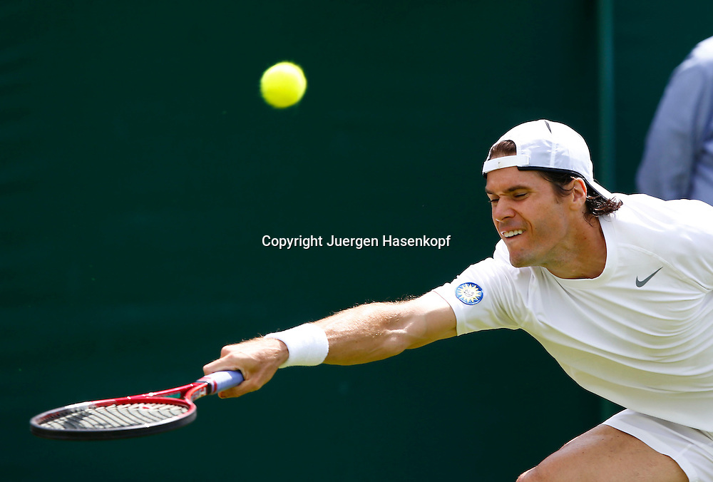 Wimbledon Championships 2013, AELTC,London,<br /> ITF Grand Slam Tennis Tournament, Tommy Haas(GER),Aktion,Einzelbild,Halbkoerper,Querformat,