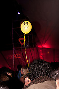 HAPPY SMILY ACID HOUSE FACE BALLOON FLOATNG ABOVE CLUB CROWD ON A STRING