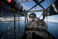 A spotter pilot looks for herring from his Super Cub during an opening of the 2007 Sitka Herring Sac Roe fishery.