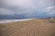 Tire tracks cover the sand of Hermosa Beach after the most prominent storm of 2014.