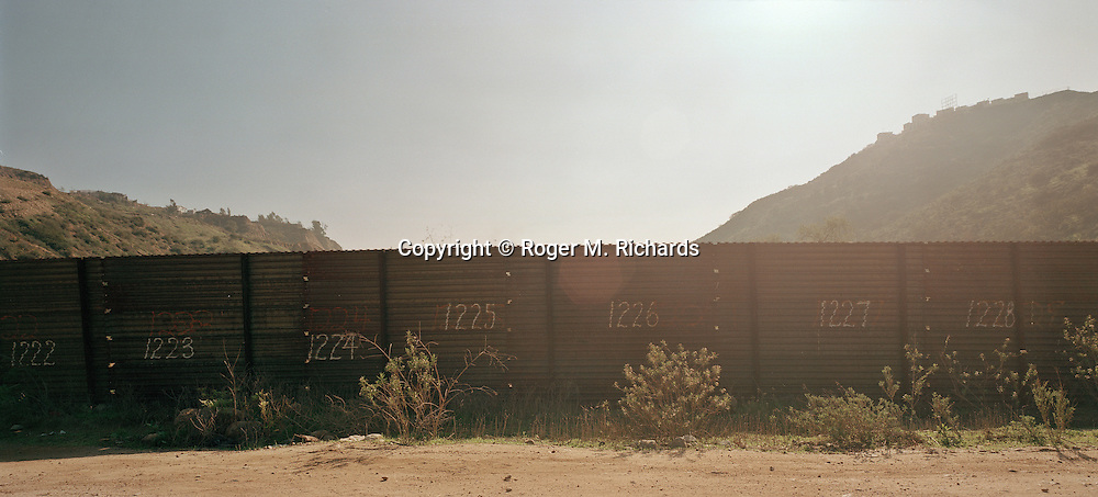 US-Mexico border fence near San Diego. Photograph by Roger M. Richards