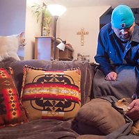 Steve Gruda pets Elmer, a stray dog he and his wife Kris rescued Sunday February 26 along west bout 1-40 near mile marker 30 in Gallup.