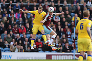 Burnley defender Michael Keane (5)  beats Leeds United striker, Chris Wood (9) in the air during the Sky Bet Championship match between Burnley and Leeds United at Turf Moor, Burnley, England on 9 April 2016. Photo by Simon Davies.