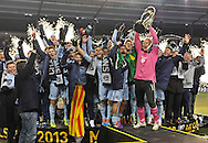Sporting KC goalkeeper Jimmy Nielsen (1) raises the MLS Cup with his team after the 2013 MLS Cup against the Real Salt Lake at Sporting Park. Sporting KC won in a shootout.