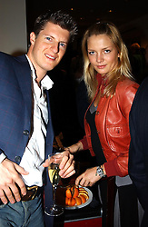 MR JEREMY SINGER and MISS GEORGIA DIENST at a party to celebrate the 21st year of Hackett held at their store in Sloane Street, London on 26th October 2004.<br /><br />NON EXCLUSIVE - WORLD RIGHTS