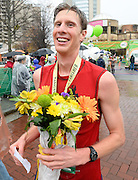 Publix Georgia Marathon male winner David McWilliams, of Decatur, holds a bouquet of flowers after his victory on Sunday, March 22, 2015, in Atlanta. David Tulis / AJC Special