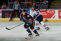 KELOWNA, CANADA - OCTOBER 13:  Liam Kindree #26 of the Kelowna Rockets skates with the puck as Parker AuCoin #32 of the Tri-City Americans back checks during third period on October 13, 2018 at Prospera Place in Kelowna, British Columbia, Canada.  (Photo by Marissa Baecker/Shoot the Breeze)  *** Local Caption ***