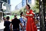 Frankfurt am Main | 27 August 2016<br /> <br /> Ein Samstag auf der Einkaufsstra&szlig;e Zeil in der Innenstadt von Frankfurt am Main, hier: Ein junge Frau in einem roten Kleid predigt und versucht, Passanten von den vermeintlichen Segnungen des Christentums zu &uuml;berzeugen.<br /> <br /> photo &copy; peter-juelich.com