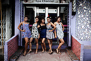 YANGON, MYANMAR, MARCH 2012: The band after getting their make-up done for the concert in central Yangon.<br /> Burma is a country in Transition. And if that hasn't been made clear enough by the political debates and the recent by-elections, meet the Me N Ma Girls, the first girlband in the country.<br /> The timing couldn't be better. After the April 1st elections in 2012 an always increasing number of investors from all over the world has been visiting Myanmar. After decades of military regime and isolation, the strings of censorship have started loosening up. The government censors in fact for years have banned songs and articles, deleting anything that was seen as &quot;to provocative&quot; such as leather outfits and colored wigs.<br /> Describing themselves as Myanmar's first all-girl group, under the management of the Australian dancer and choreographer Nicole May, these five women - coming from either Buddhist or Catholic background and formerly known as Tiger Girls - not only have been challenging censorship laws but they're as well trying to win hearts in a society that in many ways remains man-dominated and socially conservative.<br /> In a country that has been locked up for years, the Me N Ma Girls, embracing western pop culture with skimpy outfits and catchy songs, show with every performance the will of the Burmese youth to come out of a decades-long isolation.<br /> Five girls leading a new form of rebellion: the kind that questions roles and cultural norms.