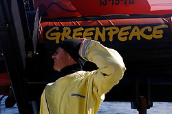 ATLANTIC OCEAN ABOARD ARCTIC SUNRISE 22MAY11 - Greenpeace action coordinator David Roberts of the UK during heli ops aboard the Greenpeace ship Arctic Sunrise...Photo by Jiri Rezac / Greenpeace