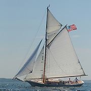 Eastward, a 32-foot-long Friendship sloop built in 1956 by Murray Peterson and owned by Robert Duncan of Concord, Mass, sails across Linekin Bay, near Boothbay Harbor, Maine.