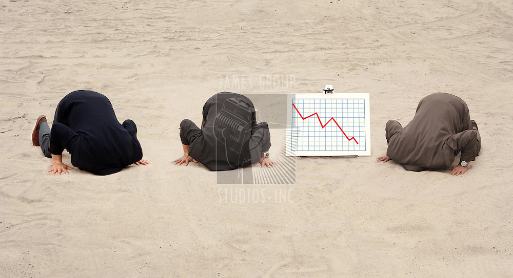 Three businessmen with their heads in the sand, kneeling next to a graph showing lost revenue