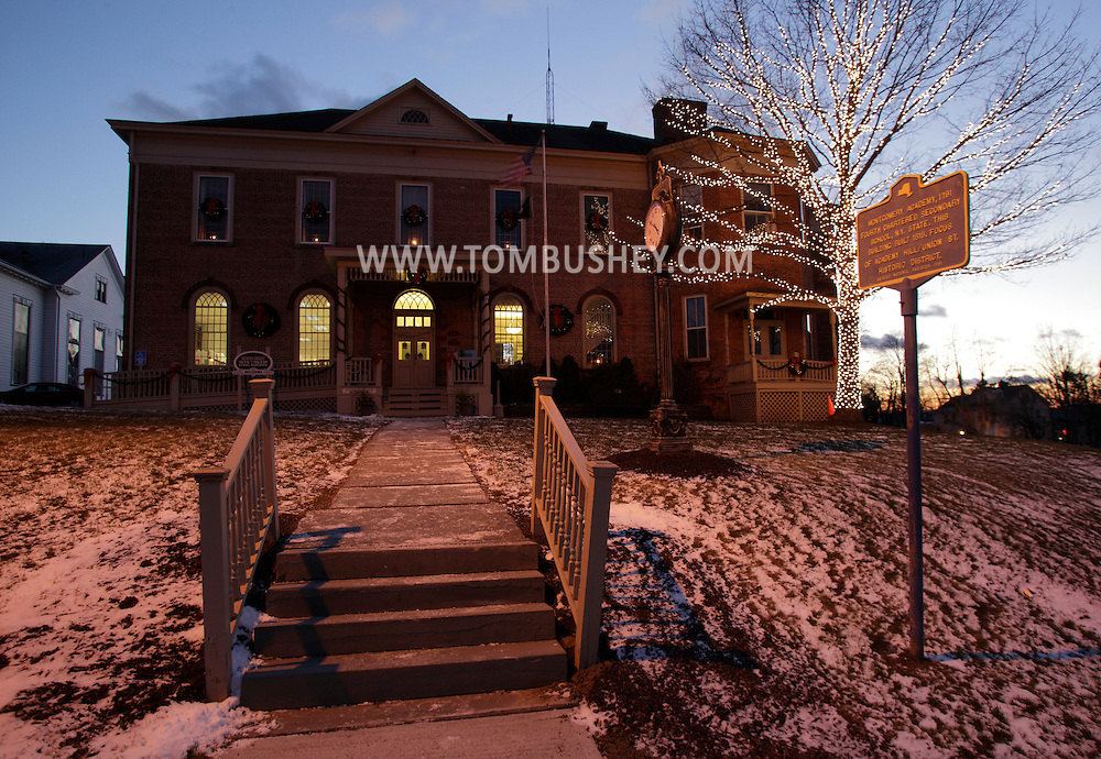 Montgomery, New York - A tree is decorated with holiday lights in front of the Montgomery Village Hall and  library on  Dec. 14, 2010. The brick structure, built in 1818, was originally the Montgomery Academy.