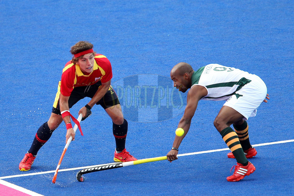 Juan Fernandez of Spain lifts the ball past Julian Hykes of South Africa during Pool MA Hockey  match between South Africa and Spain held at the Riverbank Arena in Olympic Park in London as part of the London 2012 Olympics on the 3rd August 2012..Photo by Ron Gaunt/SPORTZPICS