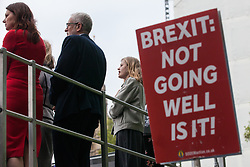 London, UK. 1st May, 2019. A placard held by Steve Bray of SODEM (Stand of Defiance European Movement) to question Jeremy Corbyn (standing on top of a double-decker bus belonging to the Fire Brigades Union) about Labour Party policy on Brexit after the Leader of the Opposition spoke at a rally to coincide with the vote in Parliament on declaring a climate emergency.