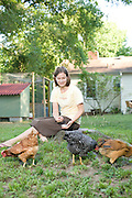 Sarah Rackley and her hens. Rackley was active in trying to change Durham's rules to allow urban chickens and now has the first legal chickens in Durham.