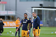 Newport County no9 Jon Parkin and no 6 Joss Labadie warming up during the EFL Sky Bet League 2 match between Newport County and Barnet at Rodney Parade, Newport, Wales on 3 September 2016. Photo by Gary Learmonth.