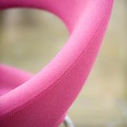 Detail shot of pink, Artifort, Nina chair.