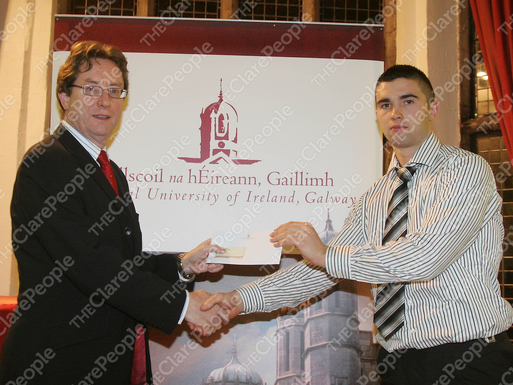 Student athletes at NUI Galway have received over ?100,000 in scholarships to help them continue to excel in their sporting fields.  Pictured receiving an NUI Galway Sports Bursary valued at ?1,000 from University President Dr James J. Browne, was hurler Caimin Morey, from Sixmilebridge, Co Clare.