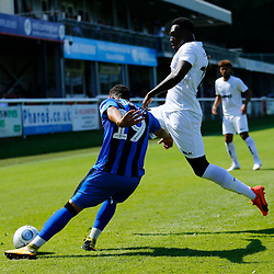 Dover's Moussa Diarra blokes the clearance of Gillingham's Aaron Simpson during the pre-season friendly match between Dover Athletic and Gillingham FC at Crabble Stadium, Kent on 21 July 2018. Gillingham ran out 3 to nothing winners. Photo by Matt Bristow.