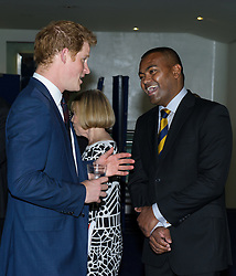 Image ©Licensed to i-Images Picture Agency. 10/06/2014. London, United Kingdom. HRH Prince Harry attends the 50th Anniversary of Zulu premiere. Picture by Anthony Upton / i-Images<br /> Leicester Square, London, 10 June 2014: HRH Pr. Harry with Johnson Beharry VC at a gala screening to celebrate the 50th Anniversary of Zulu where guests were joined by Prince Harry to watch a digitally remastered version of the iconic film. The evening was arranged to raise money for two charities supported by Prince Harry, Walking With The Wounded and Sentebale. <br /> For further info please contact<br /> Emily Conrad-Pickle Captive Minds<br /> Mobile: +44 (0)7799 414 790<br /> emily.conrad-pickles@captiveminds.com