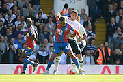 Kyle Walker and Jason Puncheon battle during the Barclays Premier League match between Tottenham Hotspur and Crystal Palace at White Hart Lane, London, England on 20 September 2015. Photo by Alan Franklin.