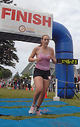 Traverse City Resident Jamie Chapman crosses the finish line and takes top honors in the female 15-19 age group at the inaugral Little Traverse Triathlon in Harbor Springs, Michigan.