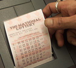 Pictures of people doing the lottery on the day Camelot lost their bid to keep the lottery in 2001. Photo by Andrew Parsons/i-Images.All Rights Reserved ©Andrew Parsons/i-images.See Instructions.