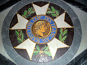 Emblem on the floor of the tomb of the French Emperor Napoleon I (bonaparte)  inside Les Invalides in Paris