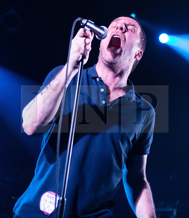 © Licensed to London News Pictures. 30/01/2015. London, UK.   Sleaford Mods performing live at Electric Ballroom.  In this picture - Jason Williamson. Sleaford Mods are an English minimalist post-punk/hip hop duo composed of vocalist Jason Williamson and musician Andrew Robert Lindsay Fearn.  The bands latest album has received critical acclaim throughout the music and national press.  Sleaford Mods songs have been described as embittered rants about such topics as unemployment, criticism of modern working life, criticism of celebrities and pop culture, capitalism and society in general.    Photo credit : Richard Isaac/LNP