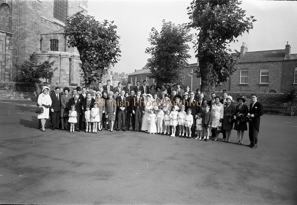 16/09/1967<br /> 09/16/1967<br /> 16 September 1967<br /> Wedding of Mr Francis W. Moloney, 28 The Stiles Road, Clontarf and Ms Antoinette O'Carroll, &quot;Melrose&quot;, Leinster Road, Rathmines at Our Lady of Refuge Church, Rathmines, with reception in Colamore Hotel, Coliemore Road, Dalkey. Image shows the whole attendance at the wedding outside the church after the ceremony.