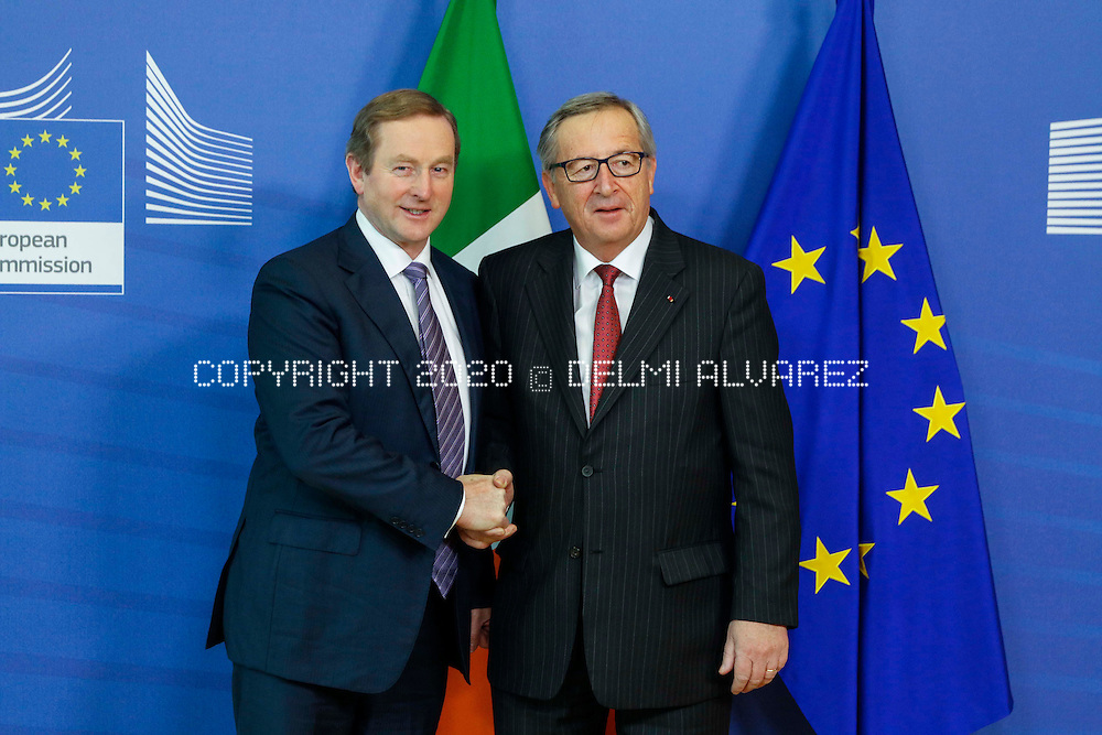 Irish Prime Minister, or 'Taoiseach', Enda Kenny (L) is welcomed by EU Commission President Jean-Claude Juncker (R), at the EU Commission headquarters in Brussels, Belgium. Photo by Delmi Alvarez
