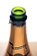 partly focussed champagne bottle neck with label