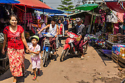02 MARCH 2014 - MYAWADDY, KAYIN, MYANMAR (BURMA): People walk through the main market in Myawaddy, Myanmar. Myawaddy is separated from the Thai border town of Mae Sot by the Moei River. Myawaddy is the most important trading point between Myanmar (Burma) and Thailand.     PHOTO BY JACK KURTZ