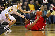 January 04 2010: Iowa Hawkeyes guard Matt Gatens (5) and Ohio State Buckeyes forward Jared Sullinger (0) battle for a lose ball during the second half of an NCAA college basketball game at Carver-Hawkeye Arena in Iowa City, Iowa on January 04, 2010. Ohio State defeated Iowa 73-68.