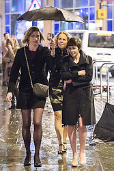 © Licensed to London News Pictures . 17/03/2013 . Manchester , UK . Three woman share an umbrella in the rain . Evening revellers out in the rain and snow in to the early hours , in Manchester this St Patrick's Day morning (17th March) . Photo credit : Joel Goodman/LNP