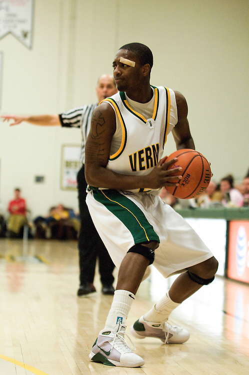 15 February 2009: Catamount junior guard Maurice Joseph #24 looks to pass the ball during the Vermont Catamounts 67-64 win over the Stony Brook Seawolves at Patrick Gym in Burlington, Vermont.