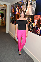 OPHELIA LOVIBOND at an exclusive showing of the Ralph Lauren Collection Spring 2014 Runway Collection held at the legendary Abbey Road Studios, Abbey Road, London NW8 on 21st May 2014.