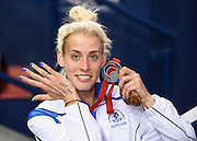 Athlete Lynsey Sharp minutes after receiving her silver medal for Scotland in the 800 metres at Hamden during the Commonwealth Games.<br /> <br /> The runner had 'Get Out Strong Commit' written as inspiration on her hand, after having a bad build up to the race.