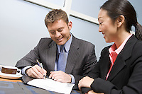 Businessman signing agreement on lunch