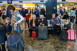 © licensed to London News Pictures. London, UK 17/04/2014. People waiting for trains at Euston Station in central London on April 17, 2014 ahead of Easter holiday. Photo credit: Tolga Akmen/LNP