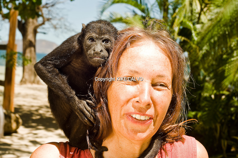 "Tamarindo, a beach town first made famous by ""Endless Summer."" The 1966 film drew international surfers, who in turn made it the condo heaven..Pictured: Owner Ursula Schmid with a baby howler monkey ( Allouata palliata ) at Capitan Suizo Hotel.  Schmid takes care of injured animals. The hotel doesn't use any pesticides in the garden and thanks to the protected old trees the hotel is often visited by wildlife such as howler monkeys, squirrels, a wide variety of birds, racoons, garrobos, iguanas and armadillos. B1276"