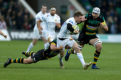 Exeter Chiefs' Will Chudley and Northampton Saints' Michael Paterson and Northampton Saints' Nic Groom during the Aviva Premiership match at Franklin's Gardens, Northampton.