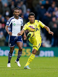 Paulinho of Tottenham Hotspur is challenged by Saido Berahino of West Brom - Photo mandatory by-line: Rogan Thomson/JMP - 07966 386802 - 31/01/2015 - SPORT - FOOTBALL - West Bromwich, England - The Hawthorns - West Bromwich Albion v Tottenham Hotspur - Barclays Premier League.