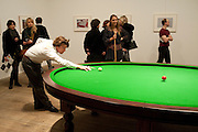PATRICIO FORRESTER PLAYING Gabriel Orozco's 'Carambole with a Pendulum?  (an oval-shaped billiard table with no pockets ), Gabriel Orozco reception, Tate Modern, London. 18 January 2010. .-DO NOT ARCHIVE-© Copyright Photograph by Dafydd Jones. 248 Clapham Rd. London SW9 0PZ. Tel 0207 820 0771. www.dafjones.com.