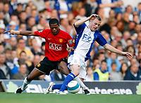 Photo: Richard Lane/Sportsbeat Images.<br />Birmingham City v Manchester United. The FA Barclays Premiership. 29/09/2007. <br />United's Patrice Evra tackles City's Sebastian Larsson.